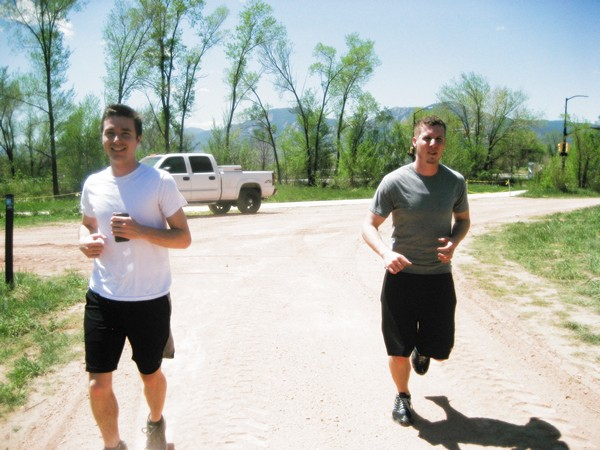 Robert and David keep a steady pace on a training run.